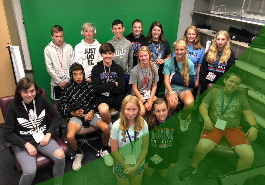Group of students in front of a green screen in their digital media class