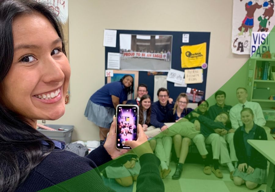 Group of students take a photo in their classroom with a green swoosh lower right corner