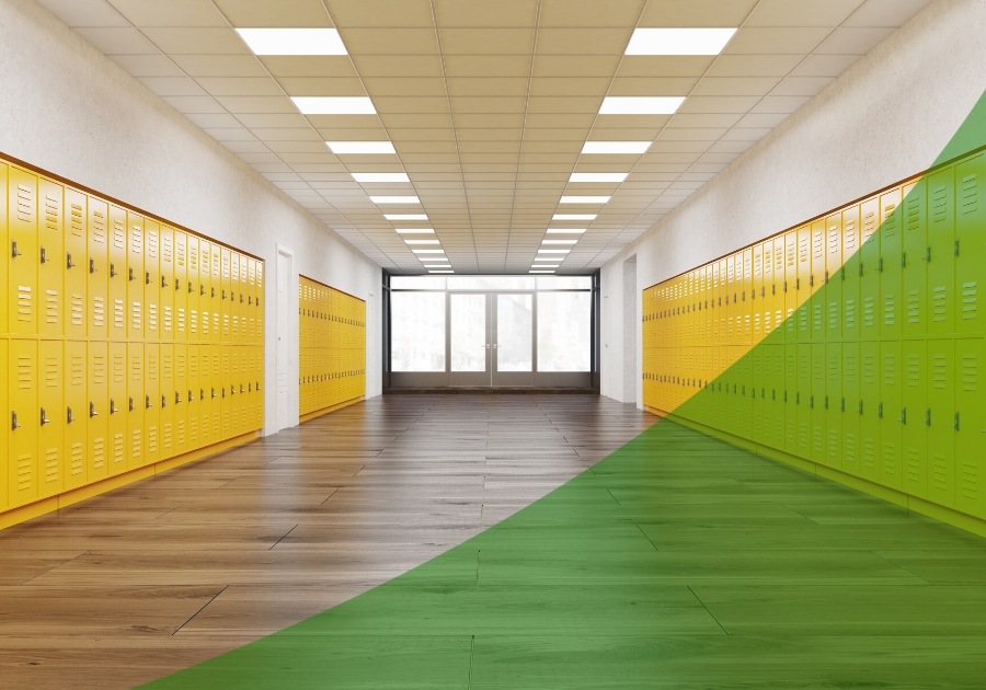 Empty hallway at school with yellow lockers and looking down to windows with a shade of green swoosh