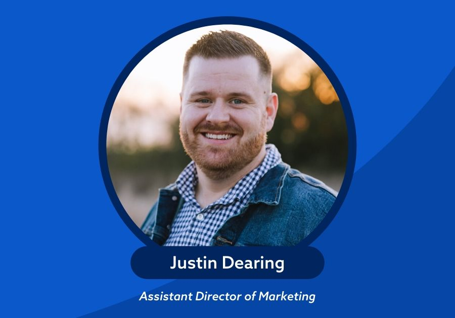 Justin Dearing photo and name Assistant Director of Marketing with a blue background