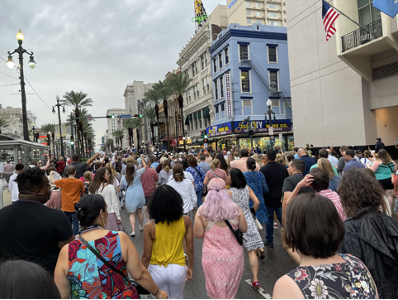 crowd of people in a street in new orleans