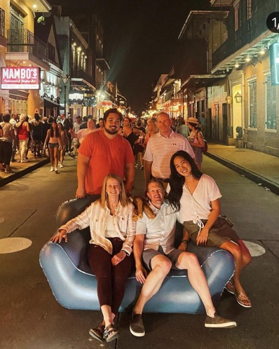 group of people around an inflatable couch in the middle of the street